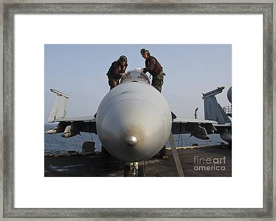 Airmen Clean The Canopy Of An Fa-18f Framed Print by Stocktrek Images