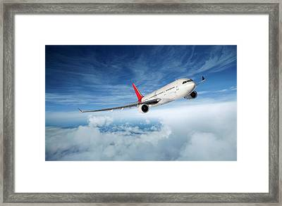 Airplane In Flight Framed Print by Aaron Foster