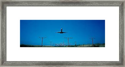 Airplane Landing Philadelphia Framed Print by Panoramic Images