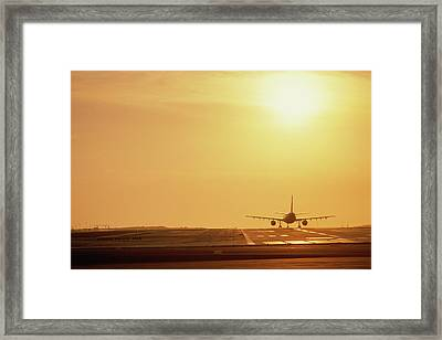 Airplane On Runway Framed Print by Panoramic Images