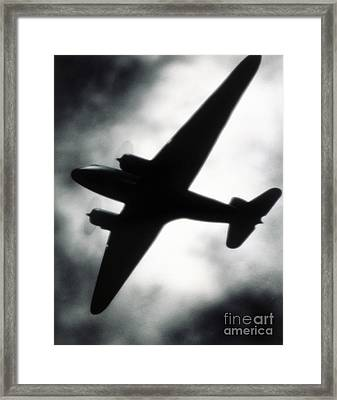 Airplane Silhouette Framed Print by Tony Cordoza