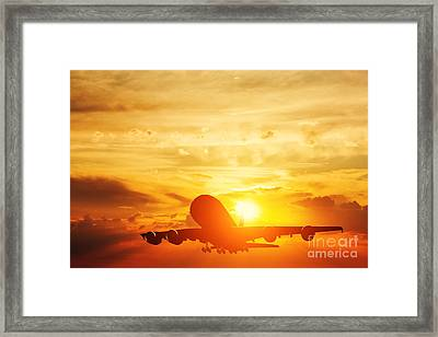 Airplane Taking Off At Sunset Framed Print