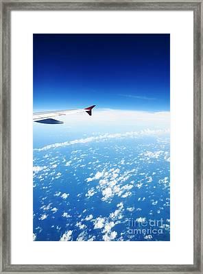 Airplane Wing Against Blue Sky Horizon Framed Print