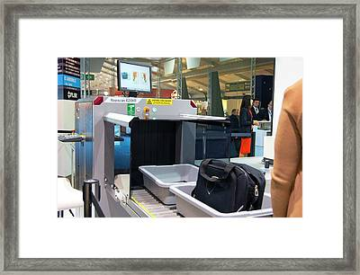 Airport Baggage X-ray Scanner. Framed Print by Mark Williamson