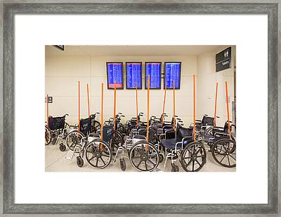 Airport Wheelchairs Framed Print by Jim West