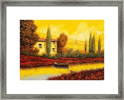 Al Tramonto Sul Fiume Framed Print