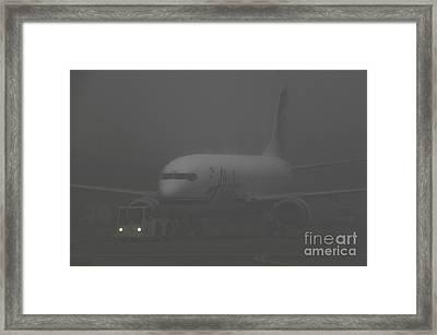 Alaska Airline Framed Print by Ron & Nancy Sanford