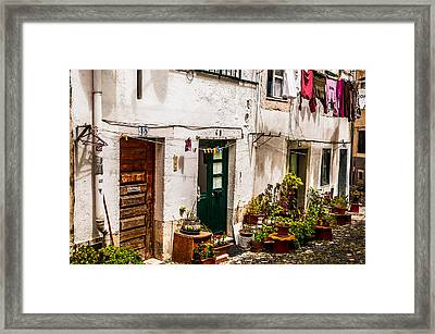 Alfama Houses Framed Print by Paul Donohoe