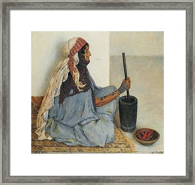 Alia Sitting And Grinding Vegetables Framed Print by Alexandre Roubtzoff