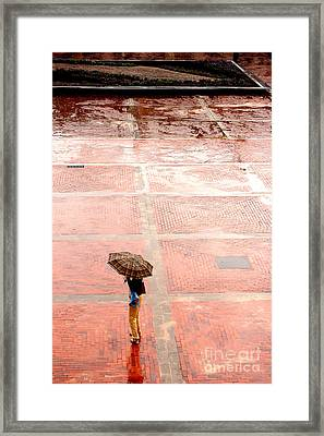 Alone In The Rain Framed Print by Michal Bednarek