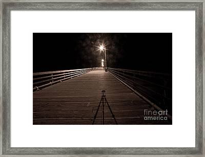 Alone On The Pier Framed Print by Ron Hoggard