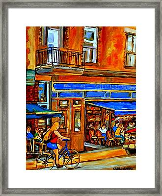 Along The Bike Path Blonde Girl Cycles Past Montreal Cafe Scene Memories Of Summertime In The City Framed Print by Carole Spandau