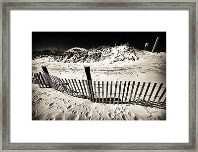 Along The Lbi Dune Fence Framed Print by John Rizzuto