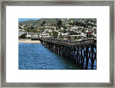 Framed Print featuring the photograph Along The Pier by Michael Gordon