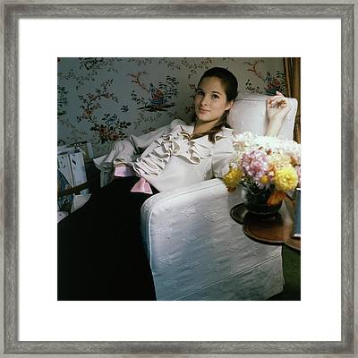 Amanda Burden Sitting In A Chair Framed Print by Horst P. Horst