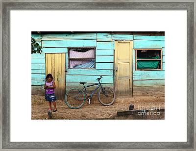 Amazon Street Scene Framed Print by James Brunker