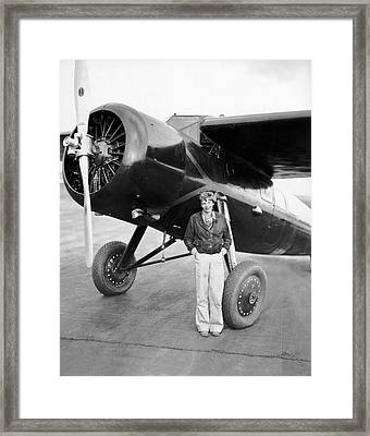 Amelia Earhart And Her Plane Framed Print by Underwood Archives