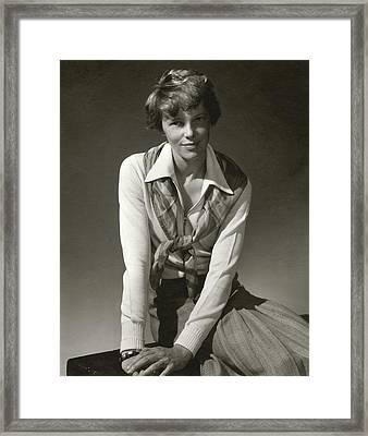 Amelia Earhart Wearing A Scarf Framed Print by Edward Steichen