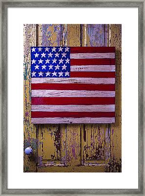 American Flag On Old Door Framed Print