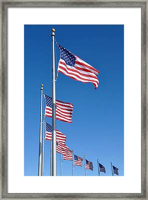 American Flag Waving In The Wind Framed Print by Brandon Bourdages