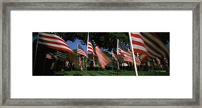 American Flags In Front Of A Home Framed Print by Panoramic Images