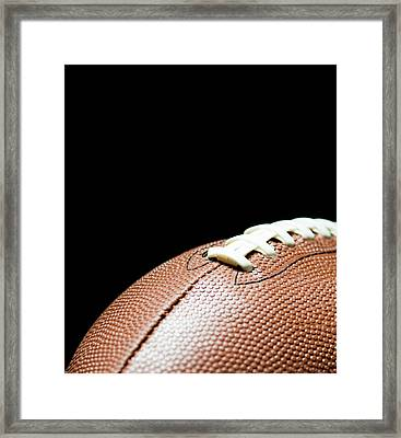 American Football On Black Background Framed Print by By nicholas