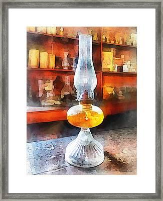 Americana - Hurricane Lamp In General Store Framed Print by Susan Savad