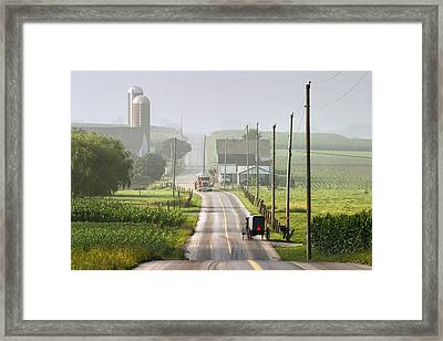 Amish Buggy Confronts The Modern World Framed Print by Randall Nyhof