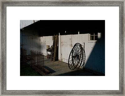 Amish Buggy Wheel Framed Print