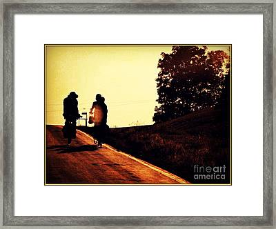 Amish Family Cycles Into Sunset Framed Print by Beth Ferris Sale