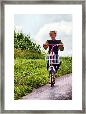 Framed Print featuring the photograph Amish Girl Scooting In Lancaster Pennsylvania Usa by Polly Peacock