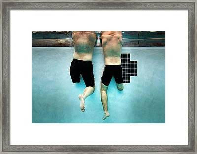 Amputee Swimmers Framed Print