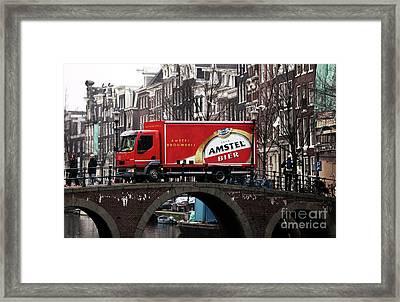 Amstel Bier Framed Print by John Rizzuto