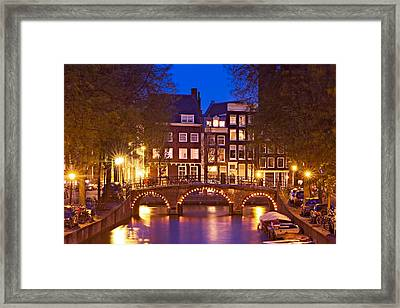 Framed Print featuring the photograph Amsterdam Bridge At Night by Barry O Carroll