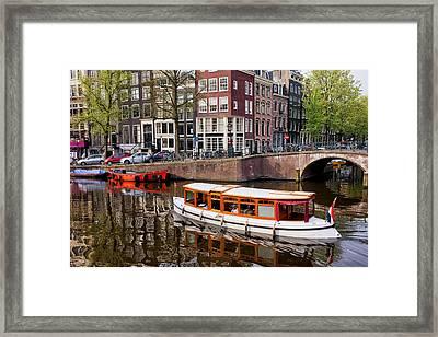 Amsterdam Canal And Houses Framed Print by Artur Bogacki