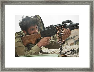 An Afghan Local Police Officer Fires Framed Print