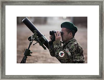 An Afghan National Army Soldier Trains Framed Print