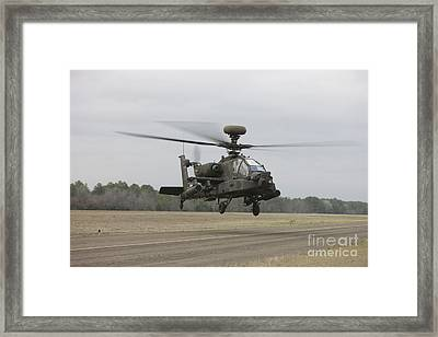 An Ah-64 Apache Helicopter In Midair Framed Print