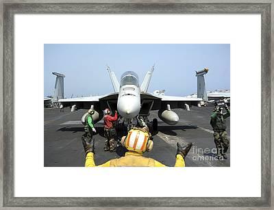 An Aircraft Director Signals Framed Print by Stocktrek Images