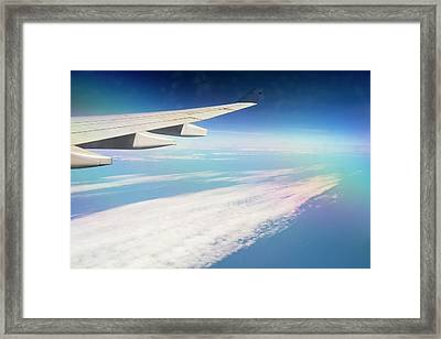 An Airplane Wing Framed Print by Ashley Cooper