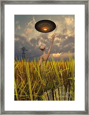 An Alien Being Directing A Ufo Framed Print by Mark Stevenson