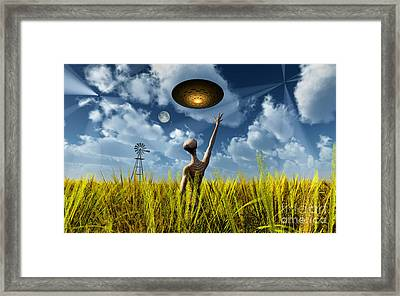 An Alien Being Directing Its Spacecraft Framed Print by Mark Stevenson