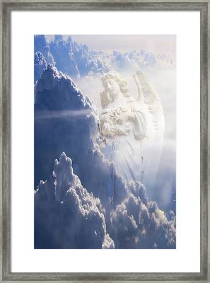 An Angel In The Clouds Framed Print by Jim Zuckerman