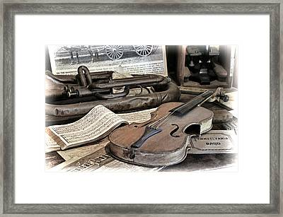 An Antique Violin Framed Print