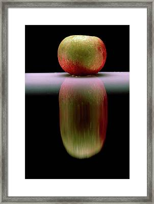 An Apple & Its Reflection In A Polished Table Top Framed Print by Mike Devlin/science Photo Library
