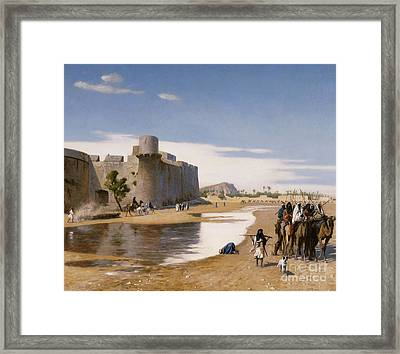 An Arab Caravan Outside A Fortified Town Framed Print
