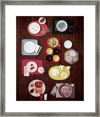 An Assortment Of Dinnerware Framed Print by Tom Yee