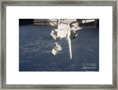 An Astronaut Carries A Pump Module Framed Print by Stocktrek Images