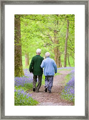 An Elderly Couple Walking Framed Print by Ashley Cooper