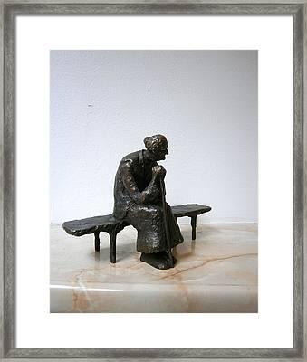 An Elderly Woman On A Bench Framed Print by Nikola Litchkov